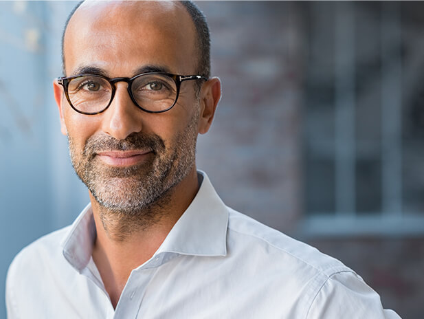bearded business man with glasses smiling wearing white color shirt