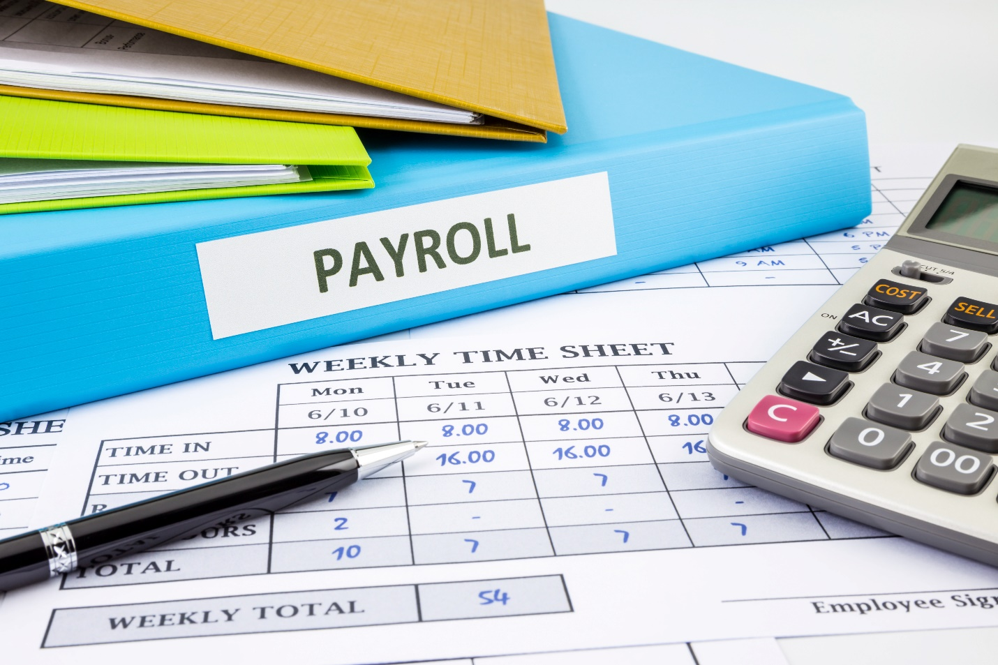 PAYROLL word on blue binder place on weekly time sheet and payroll summary report