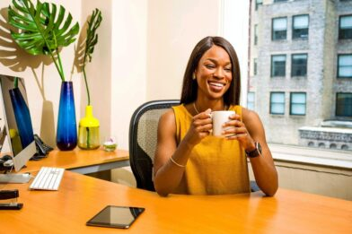 Woman Holding White Ceramic Mug At Desk