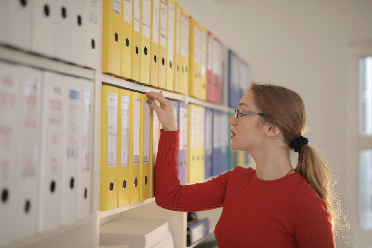 Woman Looking at Folders
