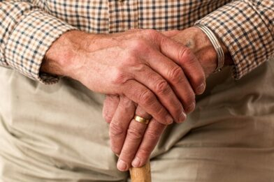 Closeup of wrinkled hands of a aged senior citizen