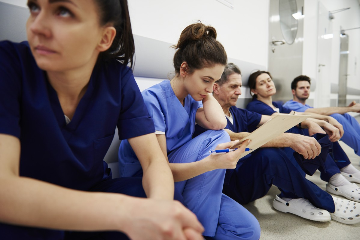 Female nurse examining medical records in the corridor