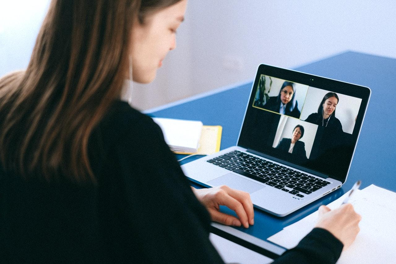 business woman using laptop to online meeting in video conference
