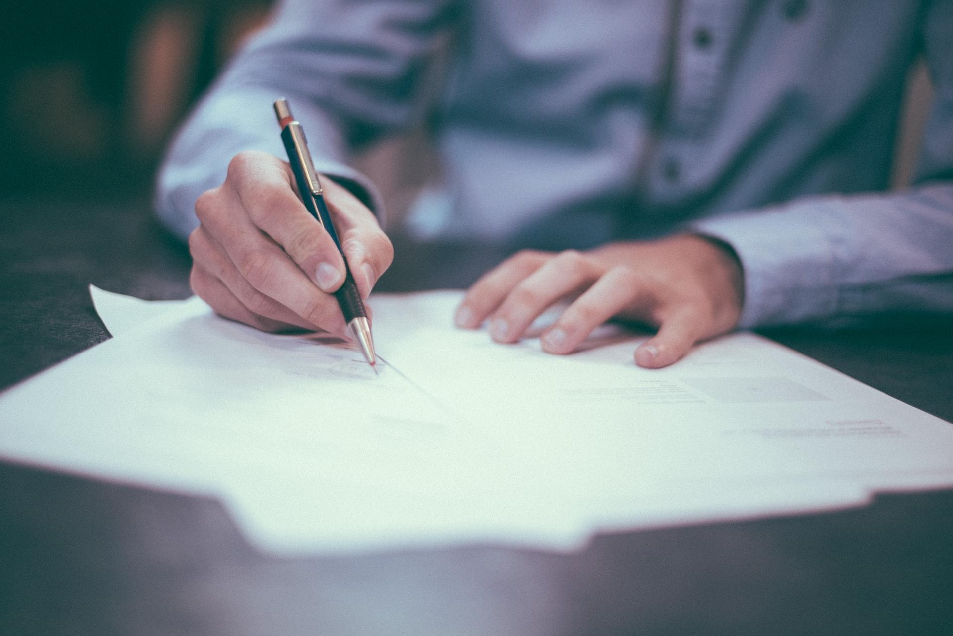 businessman is writing a letter or signing a agreement