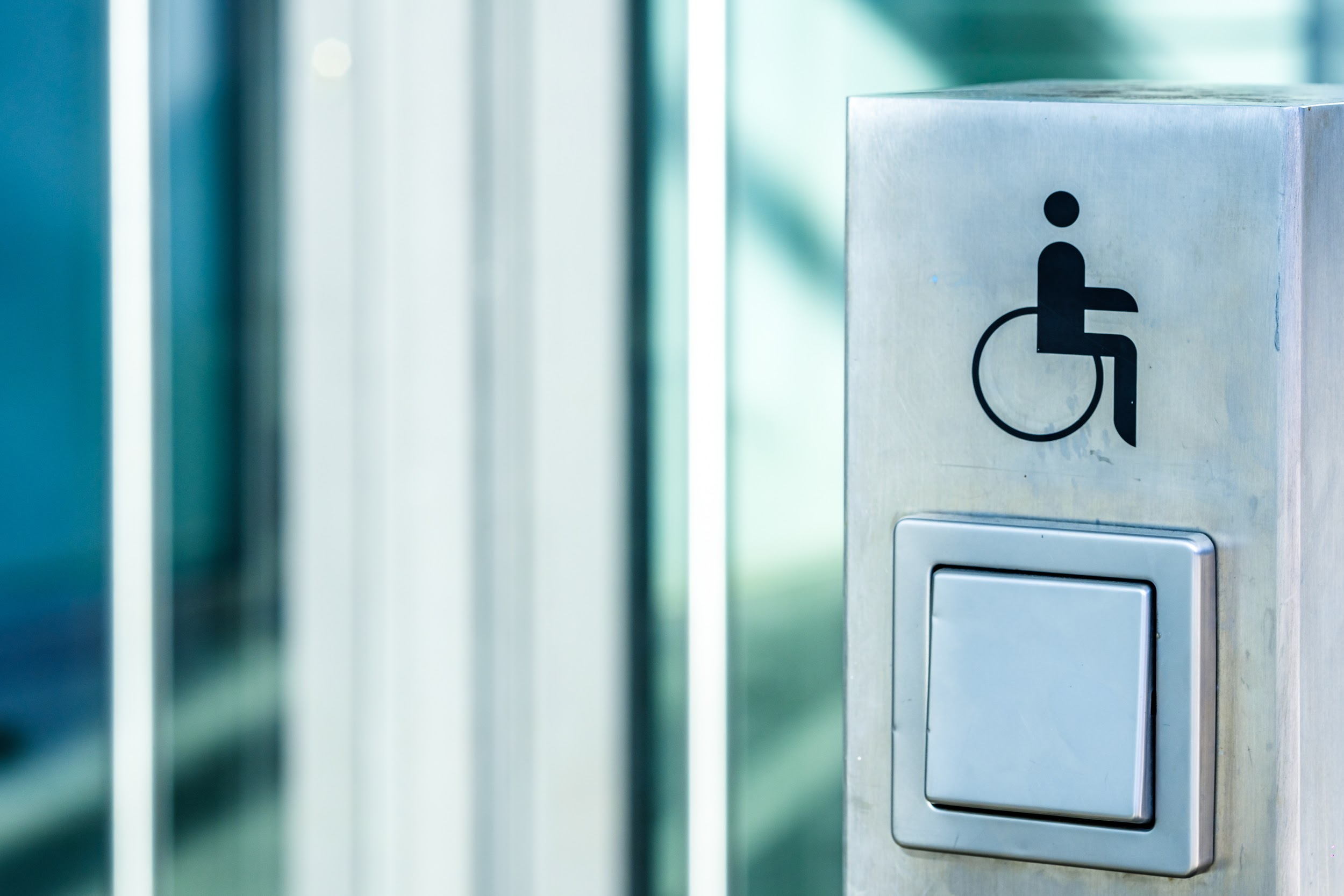 disabled sign at a door opener