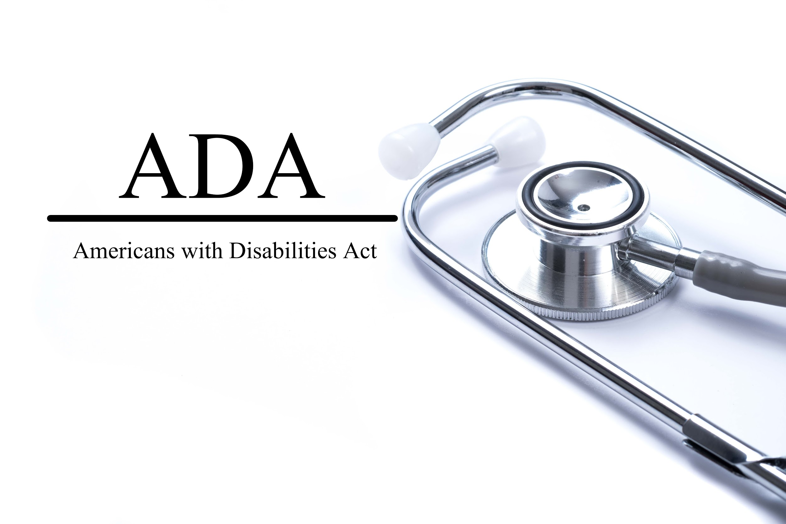 Page with ADA (Americans with Disabilities Act) on the table with stethoscope